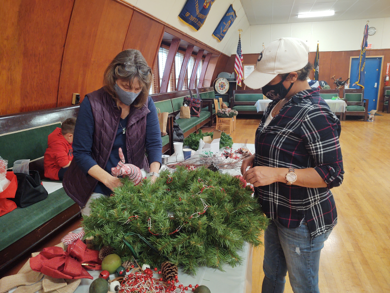 Rotarian Tina and Rotarian Marilyn bring the woods to life with their gnome creation.