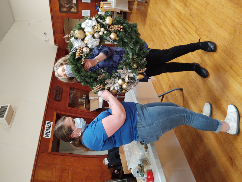 Teamwork! Rotarian Tiffany helps our 'First City Wreath Team'